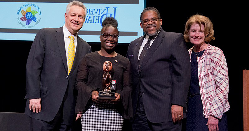 Before the coronavirus (COVID-19) pandemic made social distancing essential, 现金足球网 junior Melissa Lewis was honored with the 2020 Louis L. Redding Diversity Award. Joining her at the ceremony are (left to right) Provost Robin Morgan, Interim Vice Provost for Diversity and Inclusion Michael Vaughan and President Dennis Assanis.
